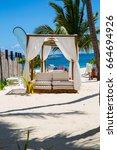 relax on a luxury vip beach...   Shutterstock . vector #664694926