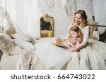 mother and daughter hugging and ... | Shutterstock . vector #664743022