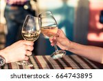 young couple with glasses of... | Shutterstock . vector #664743895