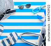 beach accessories on a blue and ... | Shutterstock . vector #664743922