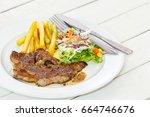 grill black pepper pork steak    Shutterstock . vector #664746676