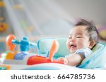 asian baby sit ob car toy and... | Shutterstock . vector #664785736