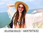 cute blonde woman making selfie ... | Shutterstock . vector #664787632