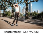 young tired woman in sportswear ... | Shutterstock . vector #664792732