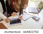 business people using a tablet... | Shutterstock . vector #664822702
