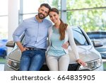 young couple buying a car  | Shutterstock . vector #664835905