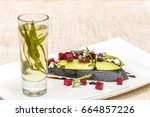 Small photo of Bruschetta with Gorgonzola, avocado and beetroot. Tarragon tinct