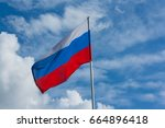 russian national flag against... | Shutterstock . vector #664896418