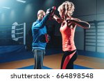 woman on self defense training... | Shutterstock . vector #664898548