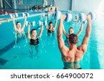aqua aerobics  healthy... | Shutterstock . vector #664900072