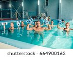 group aqua aerobics traninig in ... | Shutterstock . vector #664900162
