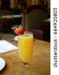 single mimosa cocktail glass ... | Shutterstock . vector #664920805