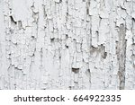 cracked painted white wooden... | Shutterstock . vector #664922335