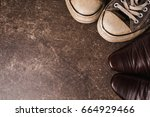 old black sneakers and brown... | Shutterstock . vector #664929466