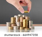 human hand putting coin to... | Shutterstock . vector #664947358