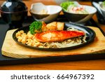 salmon steak teppanyaki... | Shutterstock . vector #664967392