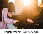 girl friends hugging watching... | Shutterstock . vector #664977586