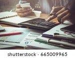 businessman calculating... | Shutterstock . vector #665009965