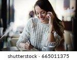 beautiful woman talking on... | Shutterstock . vector #665011375