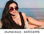 slim luxury girl.sexy brunette... | Shutterstock . vector #665016496