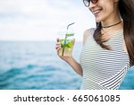 a refreshing cocktail. happy... | Shutterstock . vector #665061085