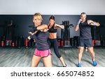 people training boxing in a...