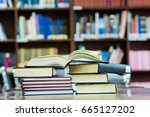 book on the table in library | Shutterstock . vector #665127202