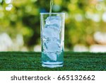 pouring water into a glass of... | Shutterstock . vector #665132662