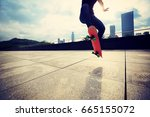young woman skateboarder... | Shutterstock . vector #665155072