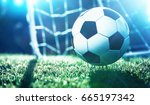 soccer ball on the field of... | Shutterstock . vector #665197342