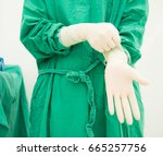 doctor or nurse putting on... | Shutterstock . vector #665257756