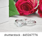 diamond rings next to white... | Shutterstock . vector #665267776