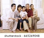 family sitting together on the... | Shutterstock . vector #665269048