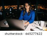 young businesswoman working on... | Shutterstock . vector #665277622