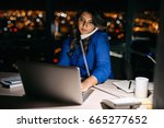 young businesswoman talking on... | Shutterstock . vector #665277652