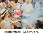 group of friends eating ...   Shutterstock . vector #665290576