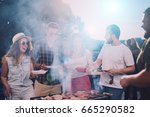 group of friends eating ... | Shutterstock . vector #665290582