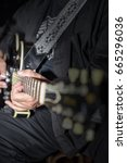 Small photo of Playing A Guitar, acoustic guitar player