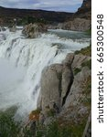 """Small photo of Nicknamed """"Niagara of the West,"""" at 212 feet in height, Shoshone Falls is taller than the aforementioned. It is located in the Snake River canyon near Twin Falls, Idaho and shown flowing high."""