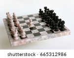 Small photo of Opening Move with Marble Chess Pieces