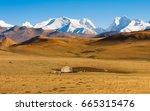 yurt in a landscape of... | Shutterstock . vector #665315476