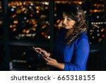 confident young businesswoman... | Shutterstock . vector #665318155