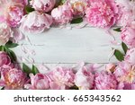Pink Peonies On A Wooden...