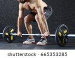 muscular man making effort... | Shutterstock . vector #665353285