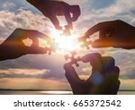 collaborate four hands trying... | Shutterstock . vector #665372542