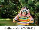 school kid girl playing with...   Shutterstock . vector #665387455