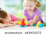 two cute little sisters having... | Shutterstock . vector #665431072