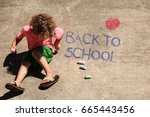 a little boy is writing back to ... | Shutterstock . vector #665443456