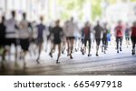 marathon runners in the city    Shutterstock . vector #665497918