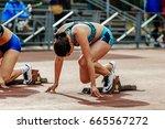 Small photo of Chelyabinsk, Russia - June 4, 2017: ready start female athlete sprinter run 100 meters during UrFO Championship in athletics